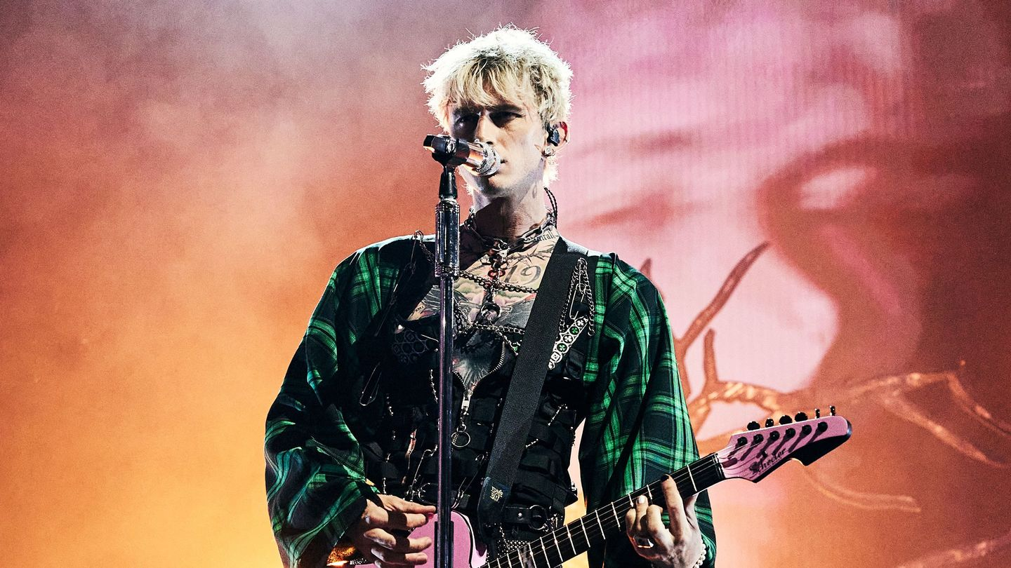 Machine Gun Kelly Lays Flowers On A Fiery Grave At The VMAs
